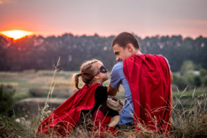 girl with dad dressed in super heroes, happy loving family 1