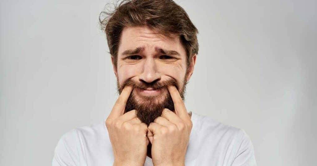 Grundemotionen_Paul_Ekman_Mikroexpressionen_Gesichtsausdrücke_Fake-Lächeln